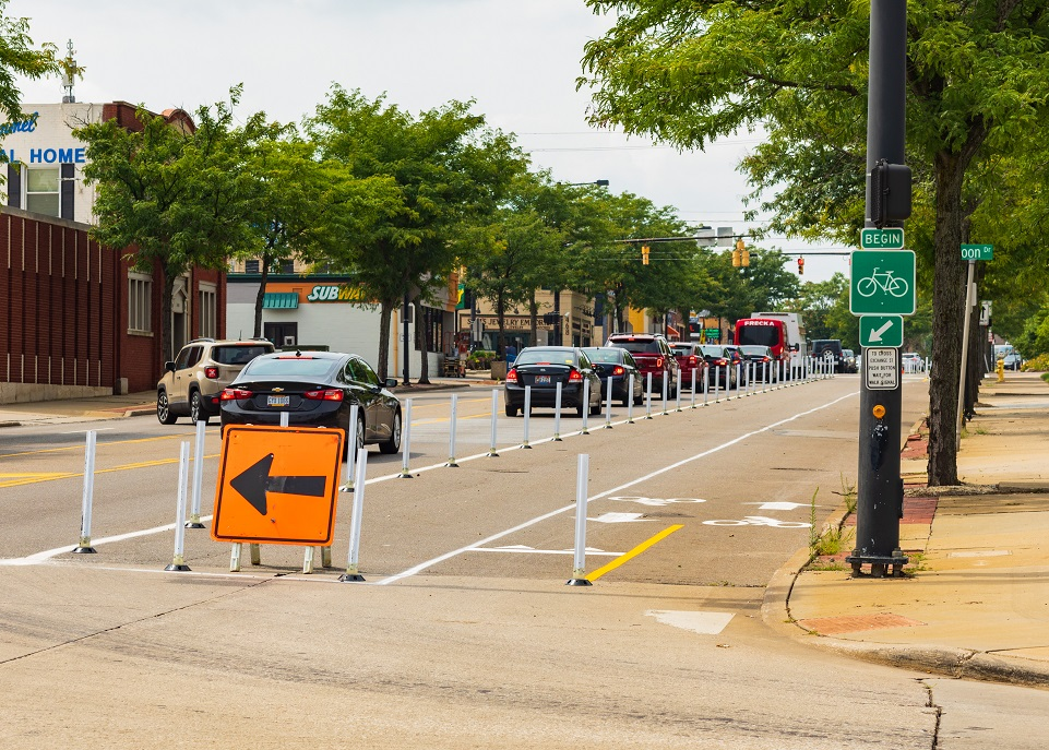 Hands On Exchange, a .75-mile bi-directional, separated bikeway Tactical Urbanism project in Akron, OH