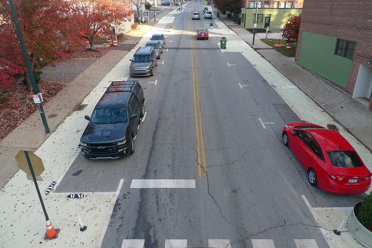 A .3-mile sidewalk extension/new shared path on Coxe Avenue in Downtown Asheville, NC revealed a 28.3% reduction in car travel speeds with no impact on the automobile carrying capacity of the street
