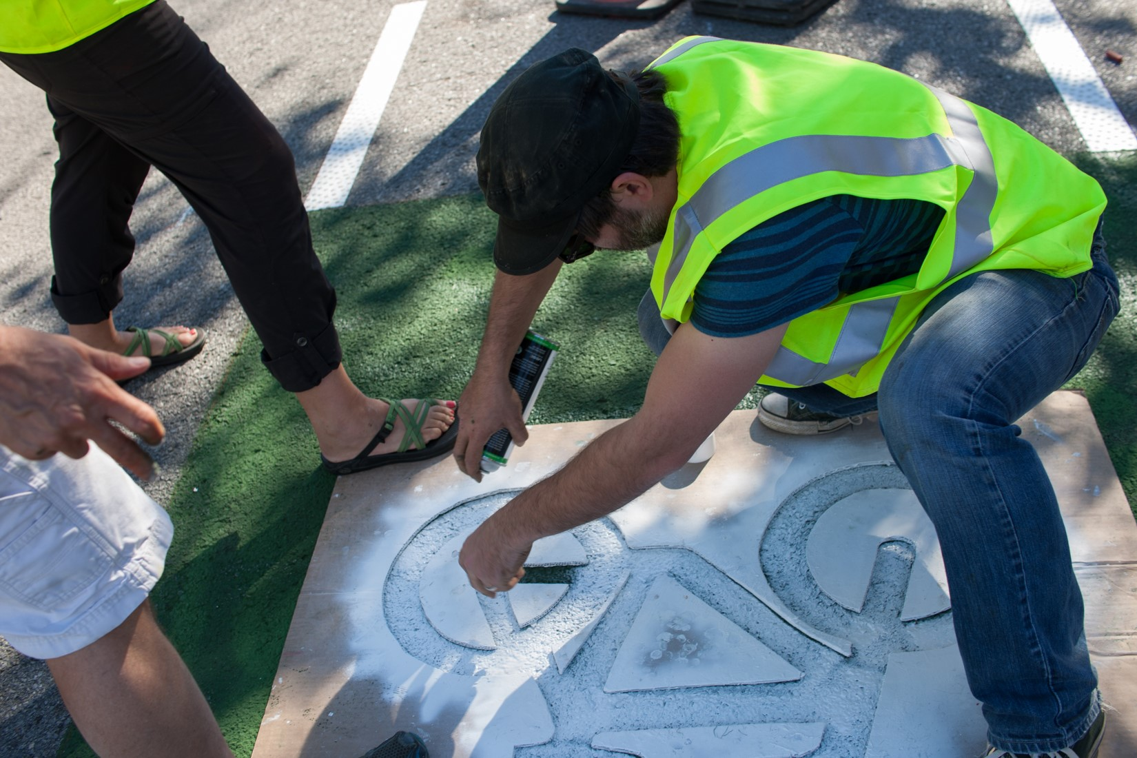 Volunteers install shared lane markings along a Neighborhood Greenway Demonstration Project in Bentonville, AR